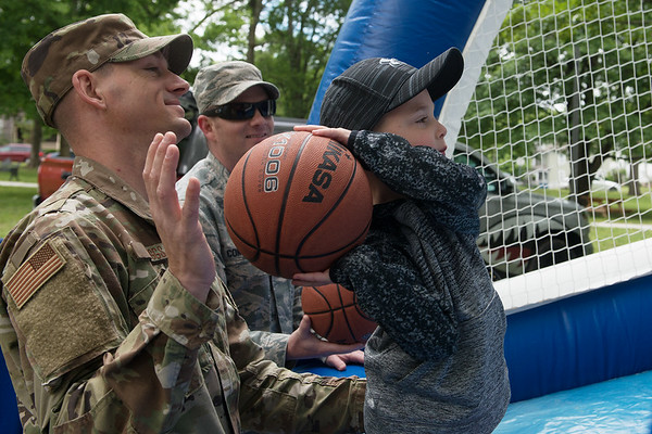 Tech Sgt. Timothy Briggs helps Creed Housh, 5, Carthage, shoot a basketball during Food Truck Friday in Carthage.<br /> Globe | Roger Nomer