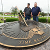 From the left: Mount Hope Cemetery Foreman Chris Ferguson and Manager Travis Boyd stand a sundial that overlooks the Veteran Memorial of  Timeless Honor at Mount Hope Cemetery on Thursday. On Memorial Day, three veterans' remains that were unclaimed for decades will be interred during a special ceremony at the Memorial.<br /> Globe | Laurie Sisk