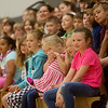 Royal Heights Elementary students watch as Bridget is introduced to the school on Monday.<br /> Globe | Roger Nomer