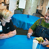 Karrie Bland, chemotherapy infusion nurse at Mercy Hospital Joplin, talks with Jeffrey Wright, Afton, during Thursday's Cancer Survivor Picnic Lunch at the hospital. The picnic also featured a musical performance by the Heritage String Quartet. <br /> Globe | Roger Nomer
