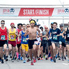 Half marathoners and 10K participants make their way out of the starting gate for the Joplin Memorial Run on Saturday at Memorial Hall.<br /> Globe | Laurie Sisk