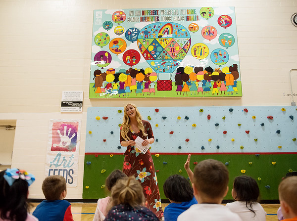 Meg Bourne, Art Feeds founder, talks to Carthage Early Childhood Center students about their mural on Thursday at the Fair Acres Famil YMCA in Carthage on Thursday.<br /> Globe | Roger Nomer