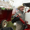 Chet Johnson, salesman with Feed Train and Applegate, talks about an ATV feeder at the Four State Farm Show on Friday near Pittsburg.<br /> Globe | Roger Nomer
