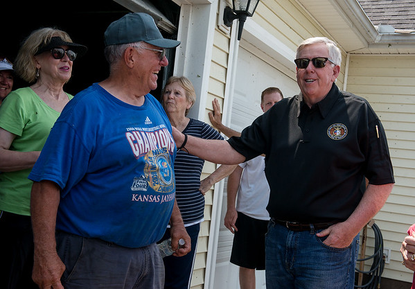 Missouri Gov. Mike Parson talks with homeowner Clyde VanWey during a visit to the Briarbrook neighborhood of Carl Junction on Thursday.<br /> Globe   Roger Nomer