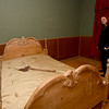 Lisa Martin, co-creator of the Paranormal Science Lab, stands in one of the bedrooms with an ominous object on the bed inside the Galena Bordello on Wednesday afternoon. The Galena landmark was part of the red light district during the mining days in Galena.<br /> Globe | Laurie SIsk