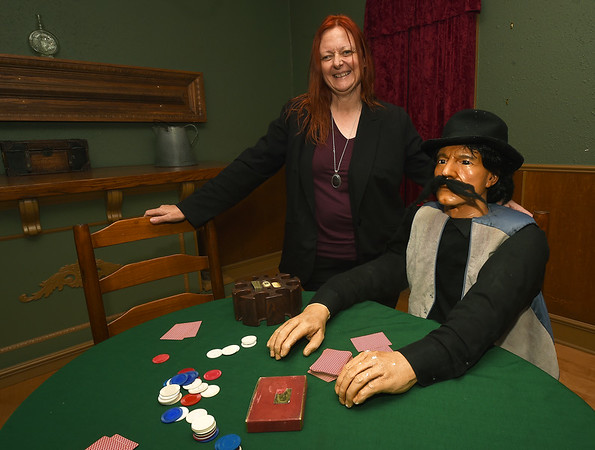 Lisa Martin, co-creator of the Paranormal Science Lab, stands beside the mannequin of a card dealerinside the Galena Bordello on Wednesday afternoon. The Galena landmark was part of the red light district during the mining days in Galena.<br /> Globe | Laurie SIsk