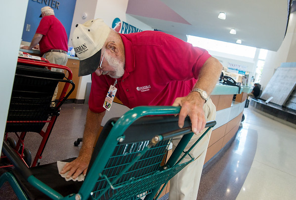Lee Roy Cristy sanitizes a wheelchair at Freeman Hospital on Friday.<br /> Globe | Roger Nomer