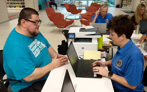 Yancy Persinger, Joplin, talks with Lana Massman, assistant director of Unclaimed Property, about an unclaimed property claim on Wednesday at the Joplin Public Library.<br /> Globe | Roger Nomer