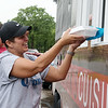 Tanya Rice picks up meals to deliver to neighbors in the Briarbrook neighborhood of Carl Junction on Thursday.<br /> Globe | Roger Nomer
