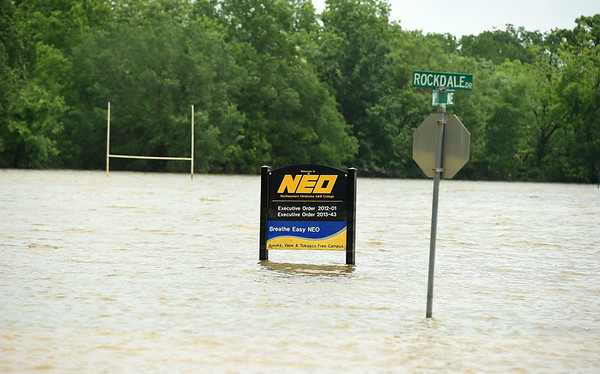 Goal posts on a football field stand submerged in water on the Northeastern Oklahoma A&M  campus Tuesday. Though the waters have receded, many areas of the town are still under water and numerous streets and roads remain closed. More rain is expected in the area in the coming days.<br /> Globe | Laurie SIsk