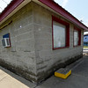 Waterlines show the extent of flooding to the concession stand at the Landreth Park Little League Fields on Thursday.<br /> Globe | Laurie SIsk