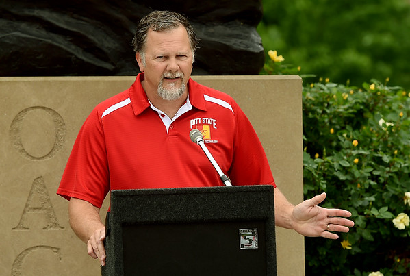 Greg Murray, chair of Engineering and Technology at Pittsburg State University, talks about the department's new Pedicab on Wednesday at Gorilla Village. The pedicycle allows volunteer pedalers in the Pittsburg community to give rides to wheelchair bound persons and those with mobility challenges. <br /> Globe | Laurie Sisk