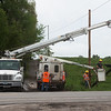 A utility crew from Minnesota help restore power to Wheaton on Wednesday.<br /> Globe | Roger Nomer