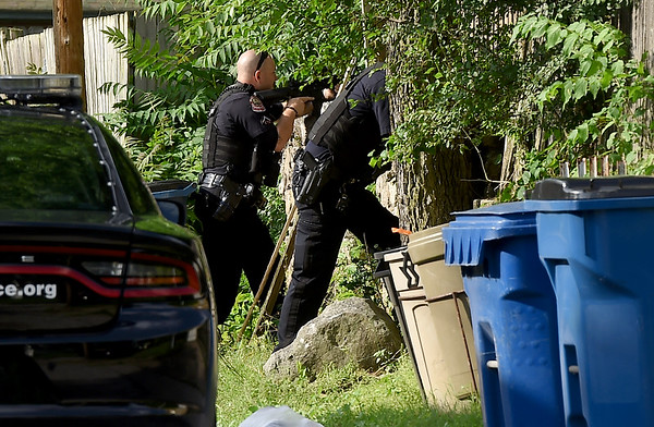 Joplin Police train their rifles from the alley behind 506 N. Byers on Monday night. Police were looking for MArvin Ward at the address.<br /> Globe   Laurie Sisk