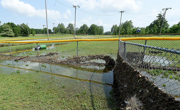 Flood debris lay washed up at the Landreth Prk Little League Fields on Thursday.<br /> Globe | Laurie SIsk