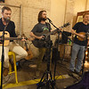Jeremiah Jones and the River Band entertain guests at the Empire Market on Saturday. From the left: Larry Chapin, Jeremiah Jones and Craig Jones. <br /> Globe | Laurie Sisk