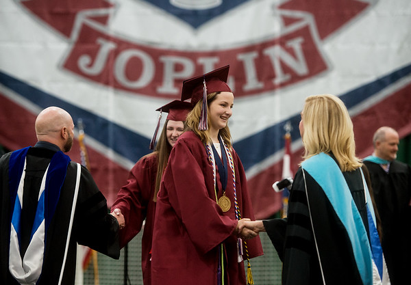 Phoebe Watson is congratulated by Superintendent Melinda Moss after receiving her diploma during Sunday's Joplin High School graduation ceremony at the Leggett and Platt Athletic Center.<br /> Globe | Roger Nomer