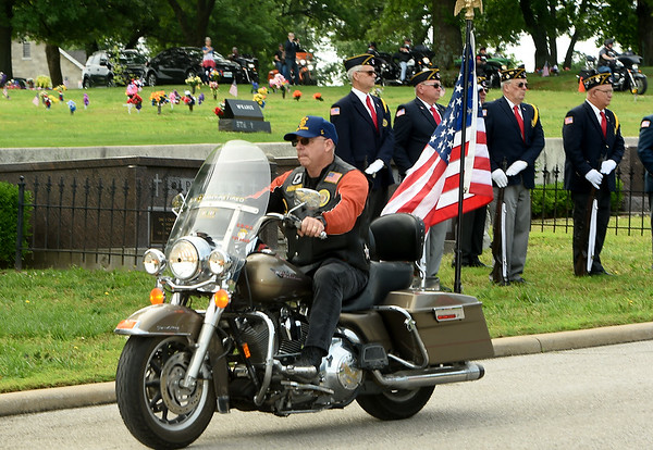 Members of the American Legion Freedom Riders present the colors during a special ceremony on Memorial Day at Mount Hope Cemetery.<br /> Globe | Laurie Sisk