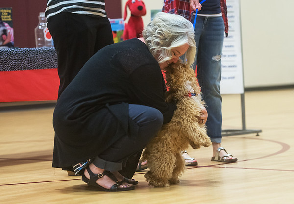 Royal Heights Elementary teacher Kate Tupper meets Bridget for the first time on Monday during an assembly at the school.<br /> Globe | Roger Nomer