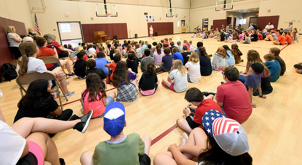 Columbia Elementary students gather for a third through fifth grade talent show inside the school's safe room on Wednesday.<br /> Globe | Laurie Sisk