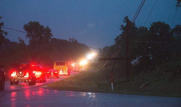 Emergency vehicles line Fir Road near Carl Junction as a power pole is damaged on Tuesday night.<br /> Globe | Roger Nomer