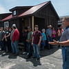 Andy McClain, Crowder technology instructor, introduces the team of students who built the tiny houses before Tuesday's auction.<br /> Globe | Roger Nomer