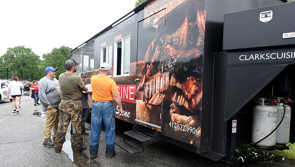 Joplin's Clark's Cuisine provides hungry relief workers hot barbecue for lunch as numerous businesses pitch in to help with cleanup and recovery after a tornado struck the Carl Junction area on Thursday night.<br /> Globe | Laurie Sisk