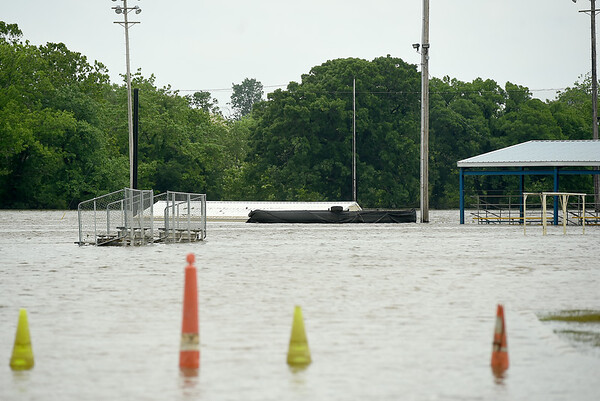 The Northeastern Oklahoma A&M baseball field stands submerged in water on Tuesday. Though the waters have receded, many areas of the town are still under water and numerous streets and roads remain closed. More rain is expected in the area in the coming days.<br /> Globe | Laurie SIsk
