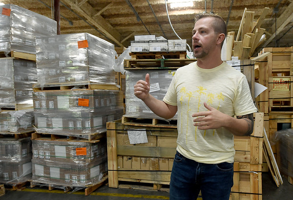 Images in Tile owner Sam Sturgis talks about the growth of his business on Tuesday at his west Joplin location. <br /> Globe | Laurie Sisk