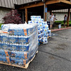 Cases of bottled water sit at Briarbrook Country Club for workers and those affected by a tornado struck the Carl Junction area on Thursday night.<br /> Globe | Laurie Sisk