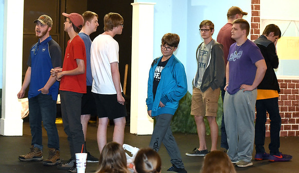 """Cast members rehearse their roles for the Stained Glass Theatre production of """"Music Man Jr."""" on Tuesday night at the theatre.<br /> Globe 