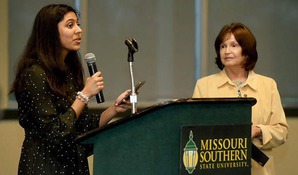 Joplin High School's Krusha Bhakta, left, talks about the influence guideance counselor johanna  Day, right, has had on her life during the 33rd Annual Joplin Globe All-Area Academic Excellence Team Honor Banquet on Thursday night at Missouri Southern. Bhatka was one of 20 area students honored at the event.<br /> Globe | Laurie Sisk