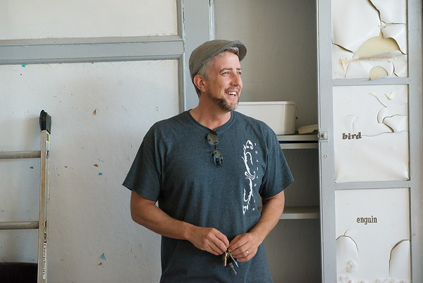 With keys in hand, Travis Hurley talks about renovating the former Washington Education Center into transitional family housing.<br /> Globe | Roger Nomer