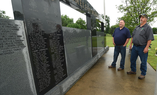 From the left: Mount Hope Cemetery Manager Travis Boyd and Foreman Chris Ferguson look through the names at the Veterans Memorial of Timeless Honor at Mount Hope Cemetery on Thursday. On Memorial Day, three veterans' remains that were unclaimed for decades will be interred during a special ceremony at the Memorial.<br /> Globe | Laurie Sisk