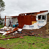 A small, brick house, a trailer and large farm equipment all suffered significant damage on Highway 126 west of Golden City in a tornado that killed three in Barton County on Wednesday night.<br /> Globe | Jordan Larimore
