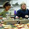 From the left: Skye Strickland, 11 and Sierra Adcock help serve dinner as part of the afterschool program on Tuesday at the Boys and Girls Club of Southwest Missouri.<br /> Globe | Laurie Sisk