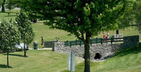 Pedestrians walk the grounds of a quiet Missouri Southern campus on Thursday at students and staff await the start of the summer semester.<br /> Globe   Laurie Sisk