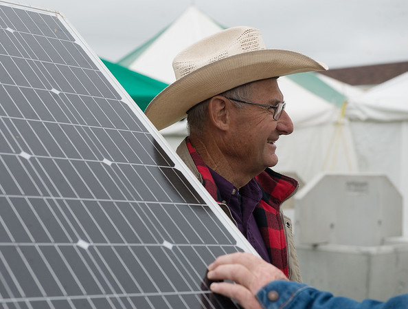 Herschel George, watershed specialist with the Kansas Center for Agriculture Resources and the Environment, talks about using solar power for pumping water at the Four State Farm Show on Friday near Pittsburg.<br /> Globe   Roger Nomer