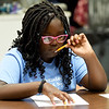 Nine-year-old Kaliyah Powell works on an essay for school during the afterschool program at the Boys and Girls Club of Southwest Missouri on Tuesday. <br /> Globe | Laurie Sisk