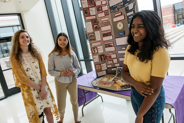 (from left) Thomas Jefferson High School students Sydney Stamps, Sonia Carlson and Johanna Jeyaraj talk about their History Day project on Bonnie and Clyde on Friday at the school.<br /> Globe   Roger Nomer