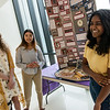 (from left) Thomas Jefferson High School students Sydney Stamps, Sonia Carlson and Johanna Jeyaraj talk about their History Day project on Bonnie and Clyde on Friday at the school.<br /> Globe | Roger Nomer