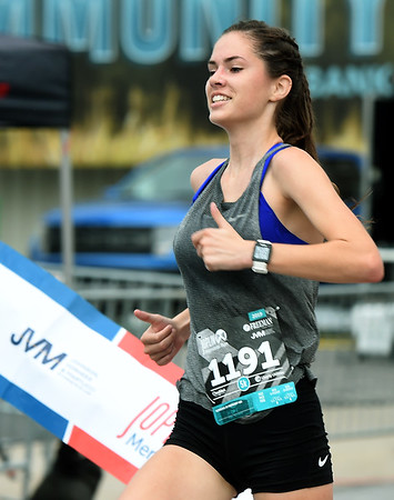 Anne Vernon captures first place in the women's 5K during the joplin Memorial Run on Saturday at Memorial Hall.<br /> Globe | Laurie Sisk