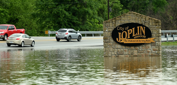 Flood waters rise to meet North Main Street near Ozark Hole no. 2 on the Ozark Christian College  on Thursday morning.<br /> Globe | Laurie Sisk