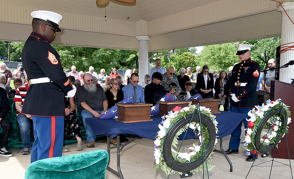 From the left: Marine Staff Sgt. William Chatman and Cpl. Hayden Thomas, members of an honor guard from Springfield, pay their respects as the cremains of Glenn R. Lake, Ralph P. Lane and Morris M. Boyd are interred Monday during a special Memorial Day service at Mount Hope Cemetery.<br /> Globe | Laurie Sisk