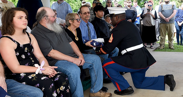 Marine Staff Sgt. William Chatman presents a a flag to the family of World War II veteran Glenn R. Lake during a special Memorial Day service at Mount Hope Cemetery.<br /> Globe | Laurie Sisk