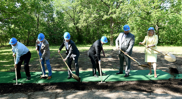 Freeman Health Systems representatives turn soil on the new Freeman Learning Center on Wednesday during a groundbreaking ceremony at the site of the 10,000 square foot center. Once open, the center will supply services for up to 90 children of Freeman employees. From the left: Danny Caylor, director of facilities management, Ryan Melton, director of service excellence, Jeff Carrier, chief clinical officer, Dr. Dennis Estep, chief medical officer, Josh Sharp, director of the learning center and Paula Baker, president and chief executive officer.<br /> Globe | Laurie SIsk