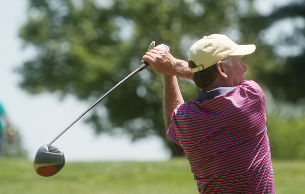 Jimmy Grimes tees off during Friday's Carthage Rotary Golf Tournament at Carthage Golf Course. The tournament raised funds to help send Carthage students to the Rotary Youth Leadership Academy and provide scholarships to students, which the Rotary recently gave out eight $1,000 scholarships to Carthage High seniors.<br /> Globe | Roger Nomer
