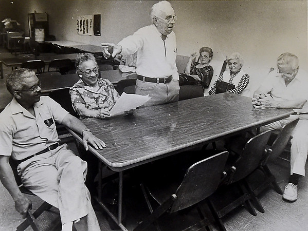 A vintage photo depicts Vernon Sigars, center, during discussions for what would later become the Vernon Sigars Viaduct.  The picture is one of several obtained by the Post Art Library for its East Town Show and Tell project on Tuesday night at Boookhouse Cinema.<br /> Courtesy Photo/Bud Smith