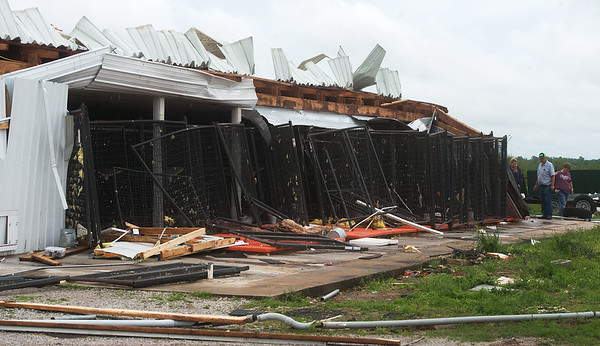 Dog kennels are damaged by a tornado on the Hughes' property near Wheaton on Wednesday.<br /> Globe | Roger Nomer