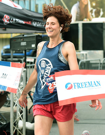 Leah Cagle captures first place in the women's 10K during the Joplin Memorial Run on Saturday at Memorial Hall.<br /> Globe | Laurie Sisk